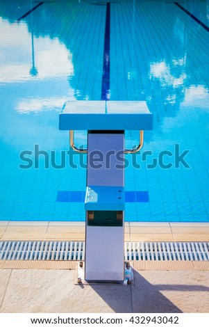 Close up of swimming pool starting block outdoors. Swimming competition concept.   - stock photo