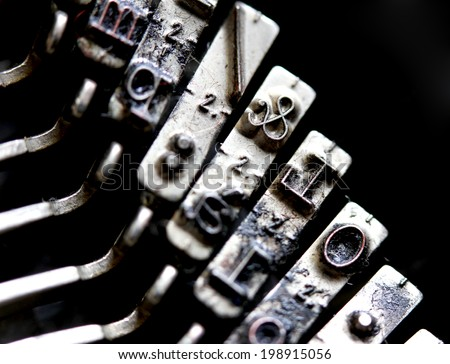 close up of symbol & ampersand inside an ancient mechanical typewriter Italian - stock photo