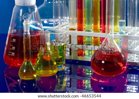 close up of syringe with sample in test tube - stock photo