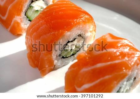 Close up of tasty fresh sushi rolls on plate - stock photo