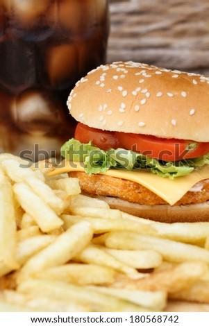 Close up of tasty hamburger, french fries and cola - Fast food