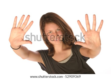 Close up of teen holding up hands - stock photo