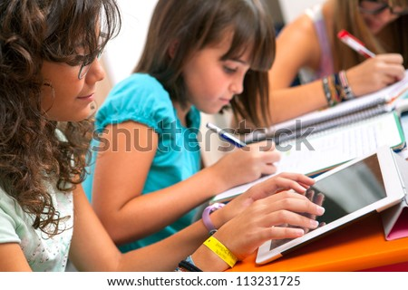 Close up of Teenage girls doing homework.