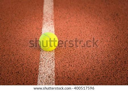 Close up of tennis ball. green color tennis ball. Tennis ball on a tennis court.   - stock photo