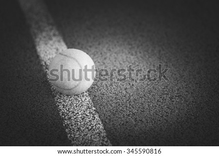 Close up of tennis ball on a tennis court. - stock photo