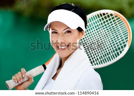 Close up of tennis player with towel on her shoulders - stock photo