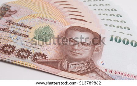 Close up of Thai banknote, Thai bath banknote with the image of Thai King Bhumibol Adulyadej. Thai banknote of 1000 Thai baht. Thai currency banknote of Thailand concepts.