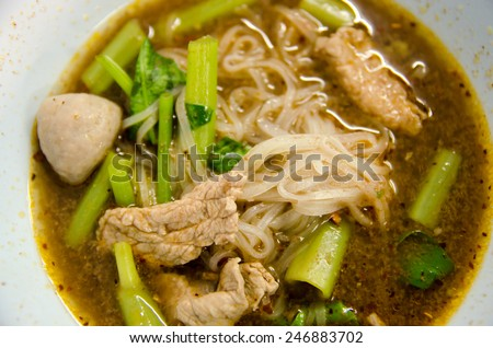 "close up of thai food  in thai country call ""Kuay Teow Nam Tok""  It's Pork noodle with blood  soup. Amazing food good mix. - stock photo"