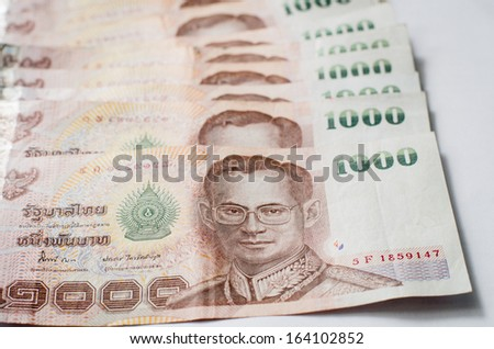 Close up of thailand currency, thai baht with the images of Thailand King. Denomination of 1000 bahts.