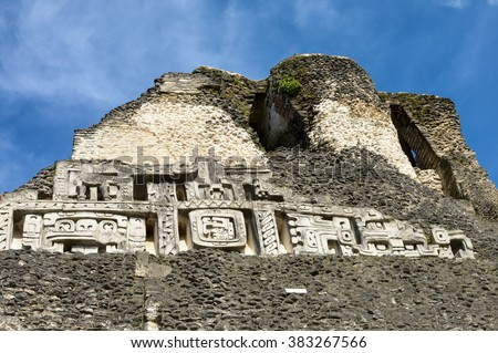 Close up of the carvings on the main pyramid El Castillo at Xunantunich archaeological site of Mayan civilization in Western Belize - stock photo