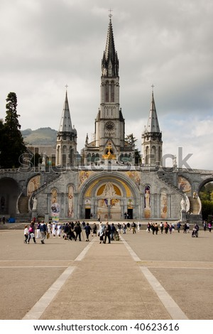 Close up of the Cathedral of Lourdes in France. Cloudy day. - stock photo