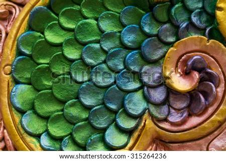 Close up of the ceramic skin covering a Naga - stock photo
