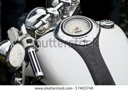 close up of the classical black and white finished motorcycle