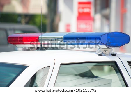 Close-up of the colorful lights on top of a police vehicle. - stock photo