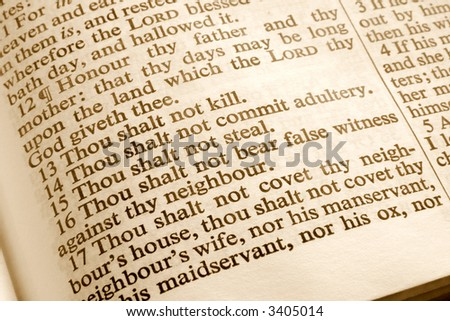 Close up of the 10 commandments in an old bible. - stock photo