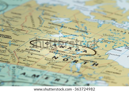 close up of the country or word Canada on a wold map - stock photo