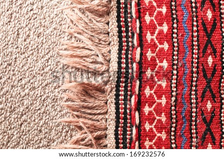 Close up of the edge of a colorful asian rug - stock photo
