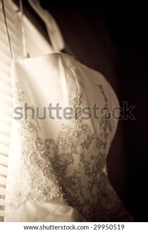 close-up of the embroidery of a wedding dress - stock photo
