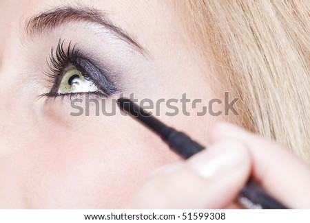 close up of the eyes of a pretty young girl - stock photo