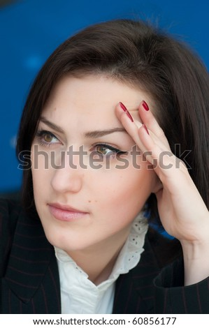 Close-up of the face of a pretty and young businesswoman - stock photo