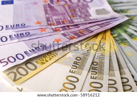 Close-up of the fan of 5, 10, 20, 50, 100, 200 and 500 Euro banknotes and coins.