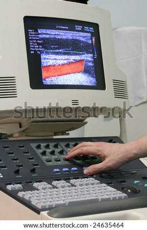 Close-up of the human hand and ultrasound machine
