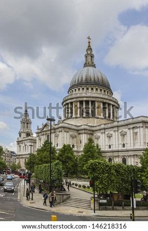 Close up of the magnificent St. Paul Cathedral Dome in London. It sits at top of Ludgate Hill - highest point in City of London. Cathedral was built by Christopher Wren between 1675 and 1711. - stock photo
