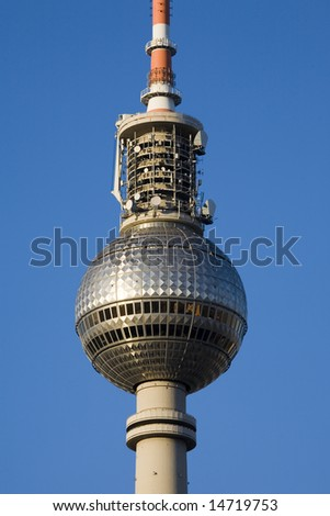 Close-up of the main section of the Television Tower in Berlin, against blue sky
