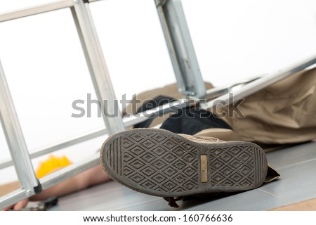 Close up of the man lying on the ground following lethal fall - stock photo