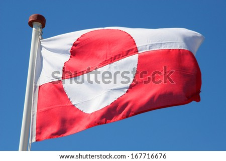 Close up of the National flag of Greenland. With a red & white half circle representing the setting sun over the ice, with the red & white contrasting background. - stock photo