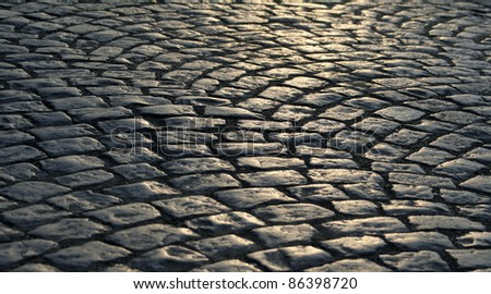 Close-up of the old pavement stones in dark colors - stock photo
