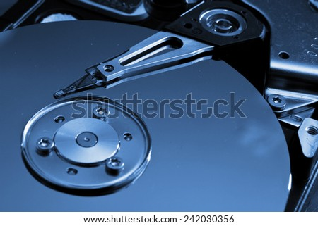 Close-up of the opened Hard Disk Drive - stock photo