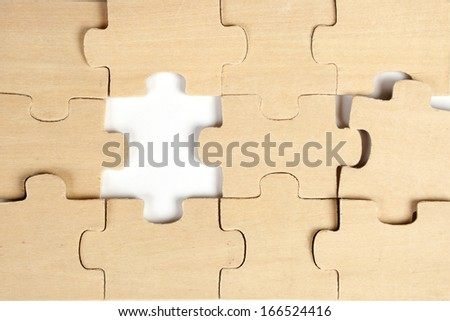 close up of the pieces of a  wooden puzzle  - stock photo