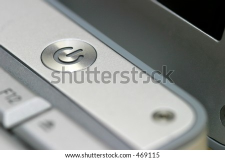 Close up of the power on and off button on a laptop - stock photo