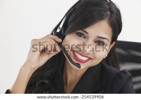 close up of the receptionist smiling,talking - stock photo