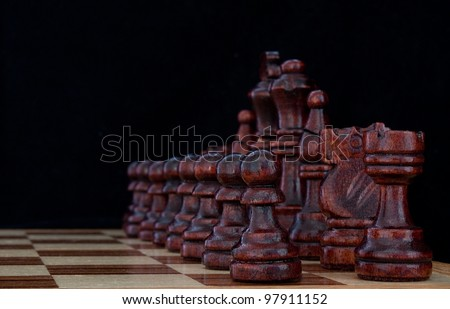 Close up of the start of a game of chess - stock photo