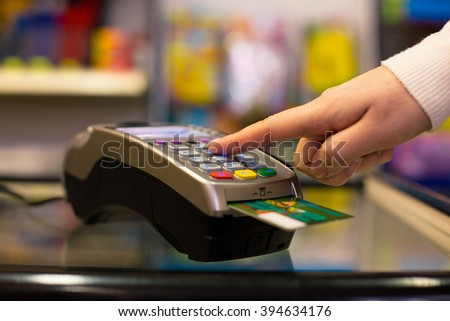 Close-up of the terminal in a supermarket - stock photo