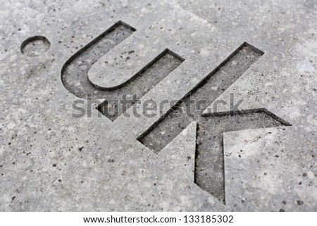 "close-up of the "".uk"" internet country code for the UK carved into stone. - stock photo"