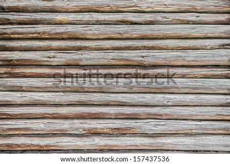 Close-up of the wall of the old pine logs - stock photo