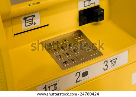 Close-up of the yellow automatic cash terminal keyboard - stock photo