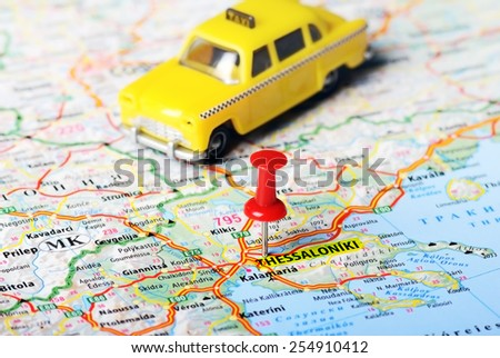 Close up of  Thessaloniki  Greece map with red pin and a taxi toy - Travel concept  - stock photo