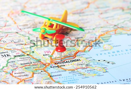 Close up of Thessaloniki  Greece map with red pin and airplane toy - Travel concept  - stock photo
