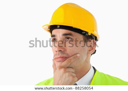 Close up of thinking architect looking to the side against a white background