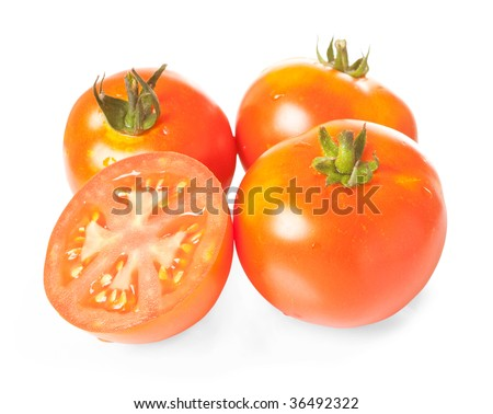 Close up of three and half tomatoes isolated on white with clipping path