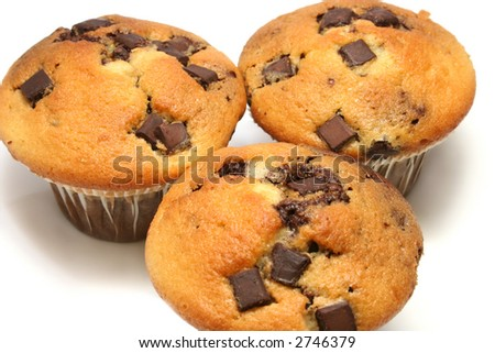 close up of three chocolate chip muffins on a white background - stock photo