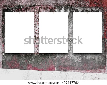 Close-up of three nailed blank frames on old weathered concrete wall background - stock photo