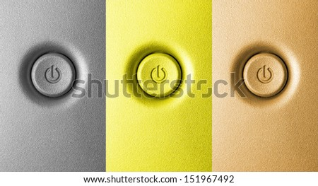 Close up of three power button on the front panel of modern personal computer in different colors: silver, gold and bronze - stock photo