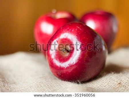 Close up of three ripe Red delicious apples on the sack - stock photo