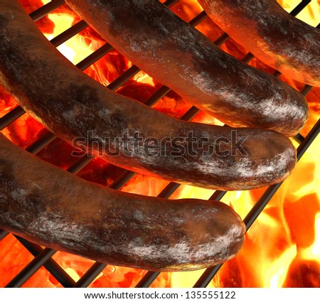 Close-up of three sausages on the grill