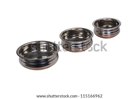 Close-up of three stainless steel cooking pots in a row